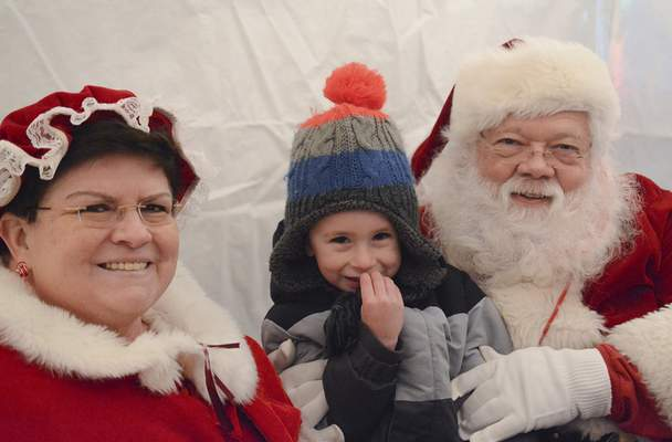 Brett Luke | The Journal Gazette Jake Moreau tells  Mr. and Mrs. Claus what he wants for Christmas during Friday's Christmas on Broadway.
