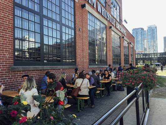 Visitors enjoy an October afternoon on the patio at Steam Whistle Brewing, one of the businesses to open adjacent to Toronto's Roundhouse Park.