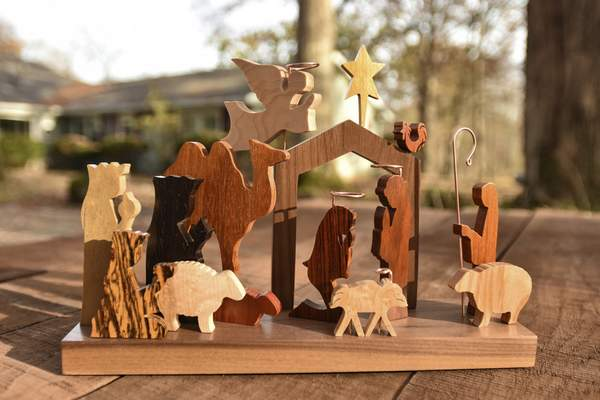 A variety of exotic woods creates a range of colors in the Nativity scenes of longtime artist Jerry Krider of Columbia City.