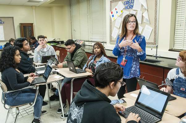 Photos by Cathie Rowand | The Journal Gazette North Side High School teacher Anna Kohl gives instructions to students in the cadet teacher program.