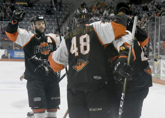 Rachel Von   The Journal Gazette  Komets' players including Shawn Szydlowski, far left, celebrate after teammate Ryan Culkin scored the second goal during the first period Saturday against Quad Cityat theColiseum.