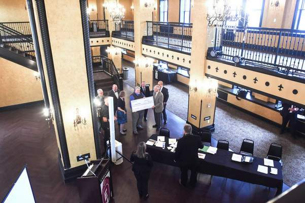 FILE: The Northeast Indiana Regional Development Authority and the state's  Regional Cities initiative present a check to the Embassy Theatre in its newly opened ballroom.