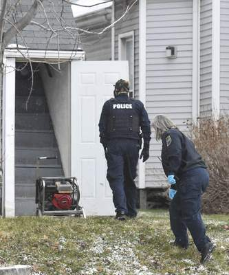 Police enter a South Calhoun Street home Tuesday afternoon where two men were found dead. (Michelle Davies | The Journal Gazette)