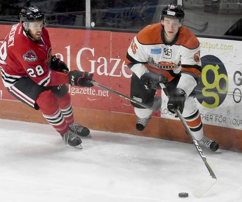 Rachel Von | The Journal Gazette  Komets' Ryan Culkin, right, and Fuel's Riley Sweeney fight for the puck during the first period of the game at Memorial Coliseum Saturday.