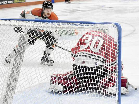 Rachel Von | The Journal Gazette  Fuel's goalie Matt Tomkins, right, guards the goal as Komets' Gabriel Desjardins tries to get a goal during the first period of the game at Memorial Coliseum Saturday.