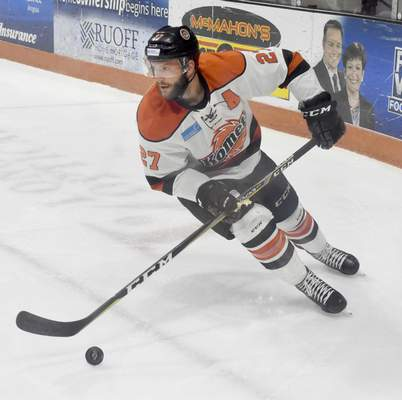Rachel Von | The Journal Gazette  Komets' Shawn Szydlowski moves the puck across the ice during the second period of the game against Indy Fuel at Memorial Coliseum Saturday.