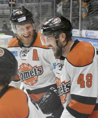 Rachel Von | The Journal Gazette  Komets' Cody Sol, left, and Garrett Thompson celebrate after teammate Jamie Schaafsma scored a goal during the second period of the game against Indy Fuel at Memorial Coliseum Saturday.