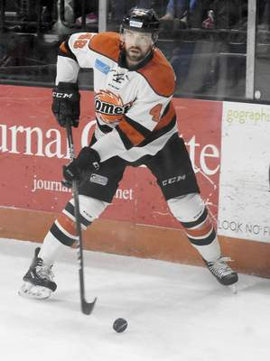 Rachel Von | The Journal Gazette  Komets' Garrett Thompson looks for a teammate to pass the puck to during the first period of the game against Indy Fuel at Memorial Coliseum Saturday.