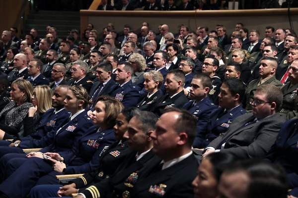 People listen as President Donald Trump speaks on national security Monday, Dec. 18, 2017, in Washington.  (AP Photo/Evan Vucci)