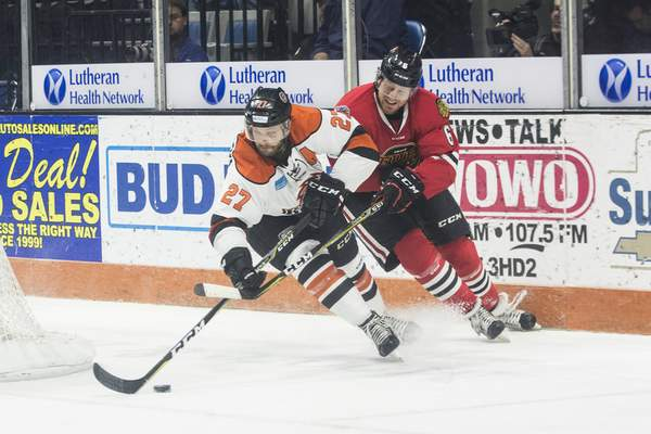 Brett Luke | The Journal Gazette  Shawn Szydlowski of the Komets steals the puck from Jack Burton of the Indy Fuel during the first periodSaturday at the Coliseum.