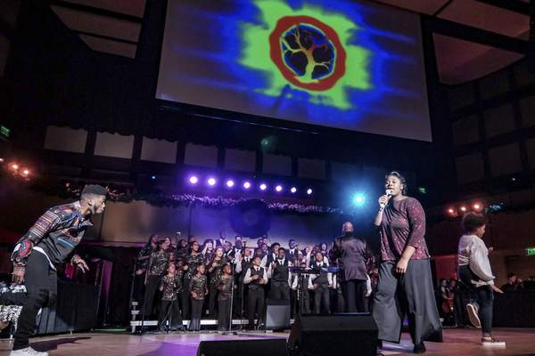 Photos by Mike Moore | The Journal Gazette The Voices of Unity Youth Choir perform Sunday in front of a packed auditorium at IPFW's Rhinehart Music Center. The program helps struggling youths realize their potential and worth.