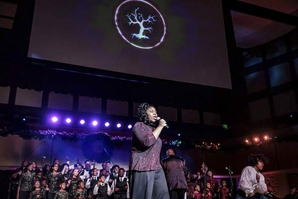 Mike Moore | The Journal Gazette Nyiann Bennett and The Voices of Unity Youth Choir perform in front of an audience during the Voices of Unity Praise Celebration held at Auer Performance Hall on Sunday.