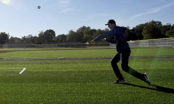 Kaleb Kolpien, 14, got in some throwing work during October's dedication of World Baseball Academy Fields at the ASH Centre.