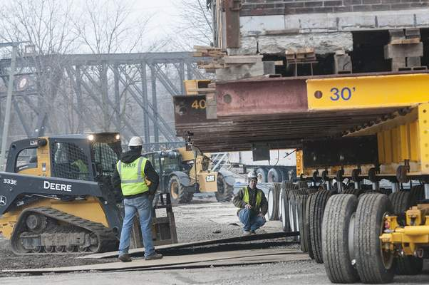 Metal sheets were placed under the wheels as the 122-year-old building was slowly moved southeast from its South Harrison Street location to a vacant lot on West Superior Street.