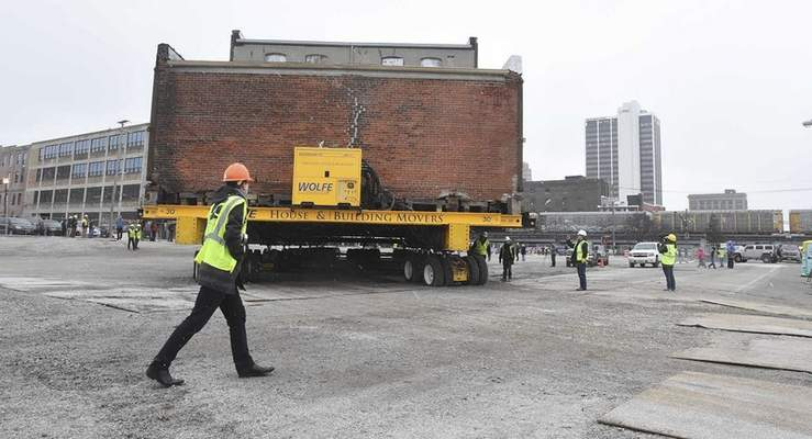 The Cambray and Associates building moves into a temporary locations from the site of Promenade Park , 312 S. Harrison St., to a vacant lot across the street, Monday, January 29, 2018.