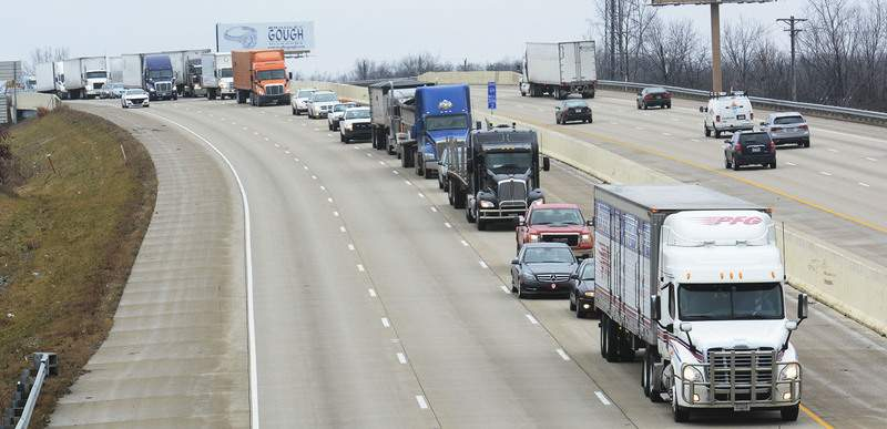 File Traffic backs up on Interstate 69 near Illinois Road after an accident in January 2017. Fewer such tie-ups are expected as driverless vehicles multiply.