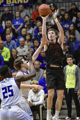 Mike Moore | The Journal Gazette North Side guard Austin Boucher shoots a the ball in the first quarter of the IHSAA sectional championship at East Noble high school on Saturday.
