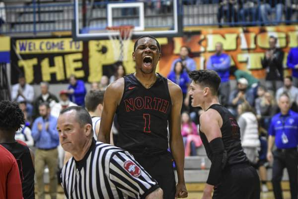 Mike Moore | The Journal Gazette North Side guard Brandan Johnson shouts with excitement after his team wins the IHSAA sectional championship at East Noble high school on Saturday.