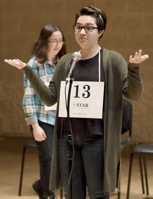 Una VanWynsberghe, 14, reacts after misspelling a word during Saturday's competition. VanWynsberghe bounced back to win the competition for a third straight year.