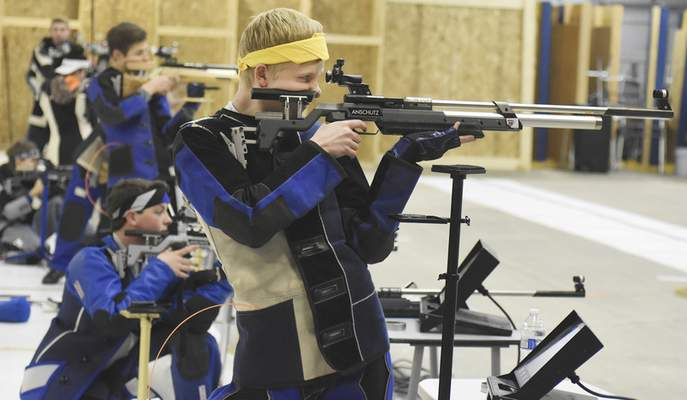 Photos by Rachel Von | The Journal Gazette Carroll's Corey Schreiber concentrates during a recent practice at the X Count facility on Merchandise Drive. The group has had seven shooters  qualify for the Junior Olympics.