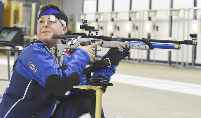 Rachel Von | The Journal Gazette  Leo's Zach Hegbli checks out his surroundings before firing during practice at The X Count on Wednesday February 28, 2018. 11 shooters have qualified for the Junior Olympics out of the X-Count facility.