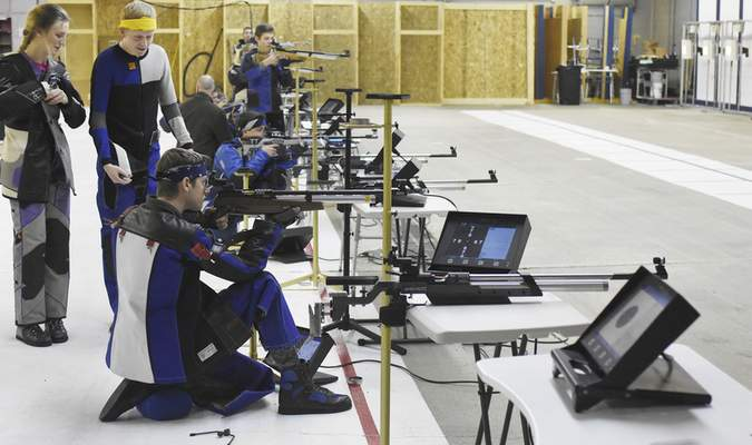 Rachel Von | The Journal Gazette  Shooters practice during practice at The X Count on Wednesday February 28, 2018. 11 shooters have qualified for the Junior Olympics out of the X-Count facility.