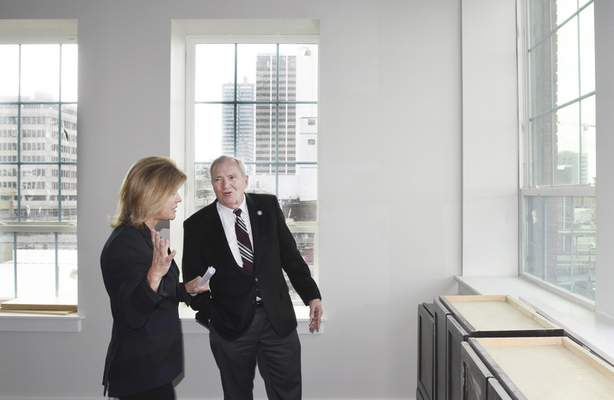Mayor Tom Henry tours Superior Lofts with Real America CEO/President, Ronda Weybright, in a corner apartment that faces Superior and Harrison Streets Wednesday. Officials toured Superior Lofts for an update of the project.
