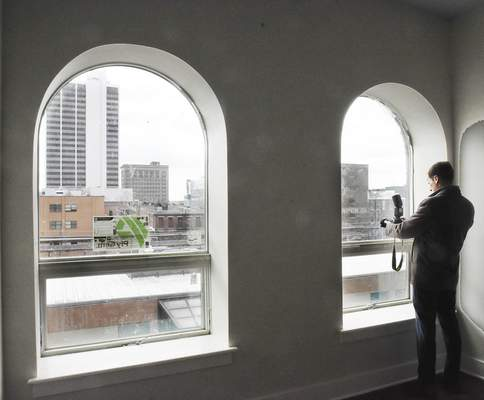 John P. Felts, Public Outreach Coordinator City of Fort Wayne, look out at the viewof Superior Street Wednesday. Officials toured Superior Lofts for an update of the project.