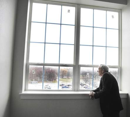 Mayor Tom Henry looks out at the view while touring touring Superior Lofts Wednesday for an update of the project.