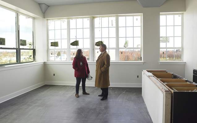 Housing and Neighborhood Services Deputy Director, Kelly Lundberg, and Geoff Paddock, 5th District City of Fort Wayne, toured Superior Lofts Wednesday with other officials for an update of the project.