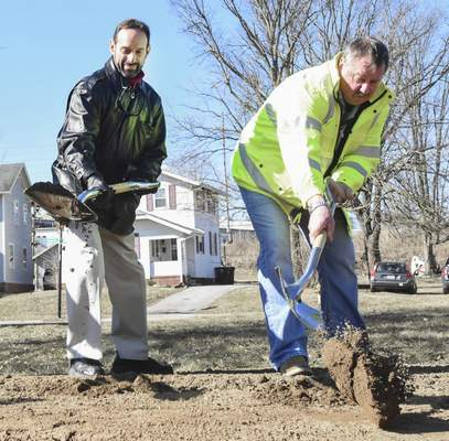 Michelle Davies | The Journal Gazette Martin Fisher, left,  executive director of Science Central, and Steve Crosby,  contractor for the Pufferbelly Trail, help break ground on the project Thursday morning.