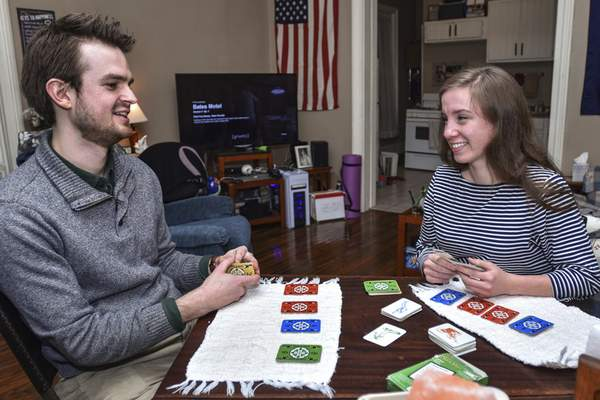 Mike Moore   The Journal Gazette For Brett Bennett, with Katie Gibson at their home, a full-time engineering job in Fort Wayne took months to find.