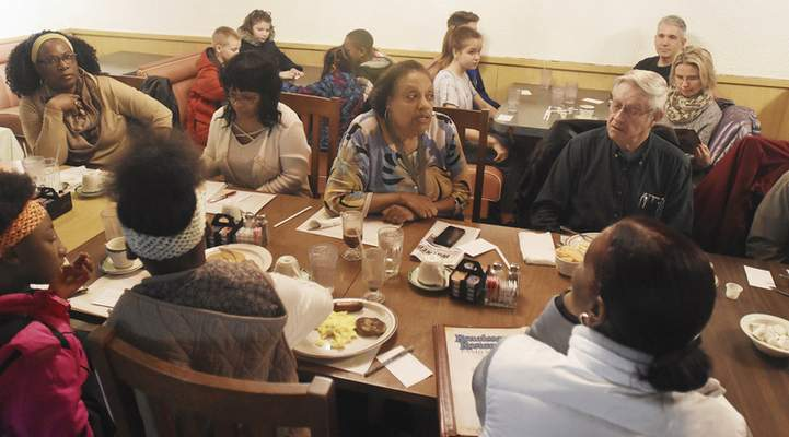 Rachel Von | The Journal Gazette  Marsha Smiley, center, speaks during the Urban Farm Hunger Relief meeting at Renaissance Restaurant on Saturday March 31, 2018.Theorganization consistsof urban growers who want to help stock food banks to feed those in need.