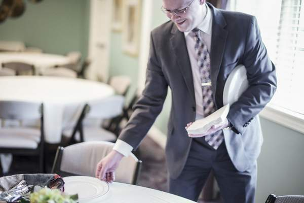 Mike Moore   The Journal Gazette D.O. McComb & Sons location manager Britton Claghorn setting tables for catering services now offered at McComb & Sons funeral home on East Dupont Road on Thursday.