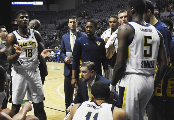 Rachel Von | The Journal Gazette  Mad Ants' coach Steve Gansey talks with his team during a time out during the first quarter oagainst the Bayhawks at the Coliseum on Tuesday.