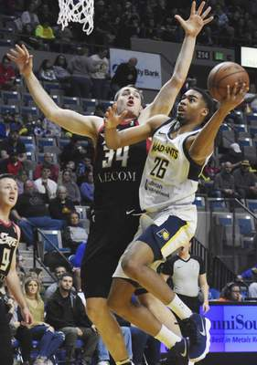 Rachel Von | The Journal Gazette The Mad Ants' Ben Moore, right, jumps up to shoot the ball as Bayhawks' Tyler Cananaugh tries to stop him during the first period at the Memorial Coliseum on Tuesday.