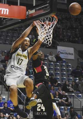 Rachel Von | The Journal Gazette The Mad Ants' Stephan Hicks, left, dunks the ball as the Bayhawks' Craig Sword tries to stop him during the first period at the Memorial Coliseum on Tuesday.