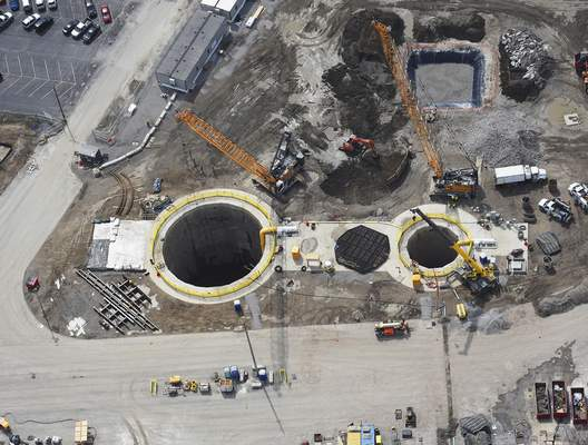 This aerial view shows the shafts for first phase of the city's overflow reduction tunnel project. The larger shaft, 66 feet in diameter, and the smaller 30-foot-diameter shaft are expected to be done by summer. (Cathie Rowand | The Journal Gazette)
