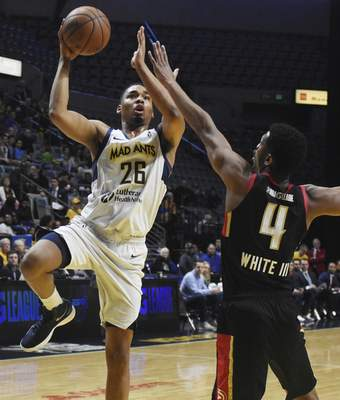 Rachel Von | The Journal Gazette The Mad Ants' Ben Moore shoots over the BayHawks' Andrew White  on Tuesday. Moore is one of six players to spend time between the Pacers and Ants this season.
