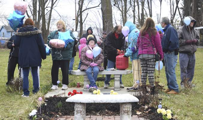 Rachel Von | The Journal Gazette Guests talk and blow up balloons during a Balloon Release event at the corner of Hoagland Ave. and W. Masterson in memory of April's death on Wednesday April 4, 2018. April Marie Tinsley was killed in 1988 by an unknown assailant.
