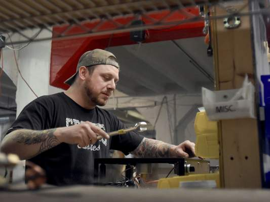 Rachel Von | The Journal Gazette Austin Hammond assembles a steam module at Modbar on Wednesday March 28, 2018. Modbar is a specialty manufacturer of coffeehouse brewing systems used by baristas to make espresso and other coffee-based drinks. VIDEO