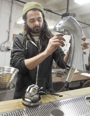 Rachel Von | The Journal Gazette Nick Ventruella works on installing the brew group into an espresso tap during work at Modbar on Wednesday March 28, 2018. Modbar is a specialty manufacturer of coffeehouse brewing systems used by baristas to make espresso and other coffee-based drinks. VIDEO