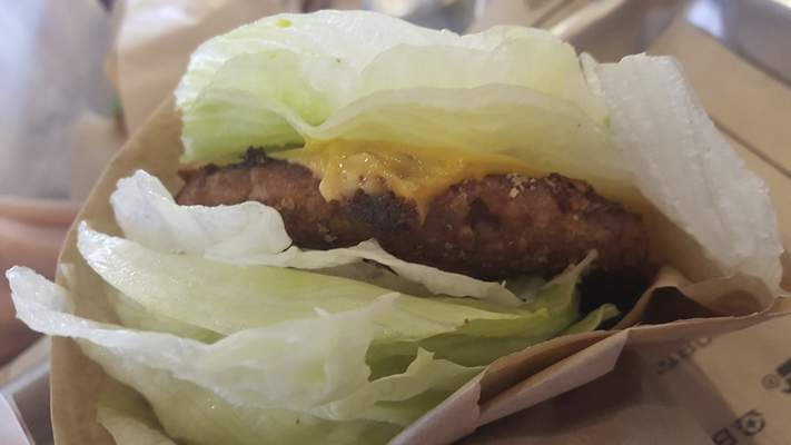 A Beyond Burger made with a vegan Beyond Meat patty done green style -- lettuce in place of a bun -- at BurgerFi on Coldwater Road.
