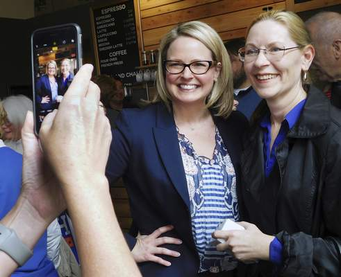 Democratic congressional candidate Courtney Tritch, left, poses for a photo at Three Crowns Coffee in Warsaw with Shari Benyousky, the Democratic candidate for trustee for Kosciusko County's Wayne Township. (Brian Francisco | The Journal Gazette)