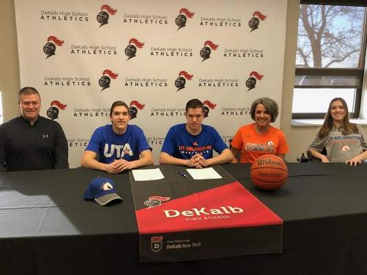 Courtesy DeKalb seniors Isaac, second from left, and AJ Hummer, center, recently signed their national letters of intent to attend the University of Texas-Arlington and receive scholarships to play for the Movin' Mavs wheelchair basketball team. They were joined at signing day by their father, Jim, far left, mother Kristy Cobbs and sister Kendra Hummer, far right.