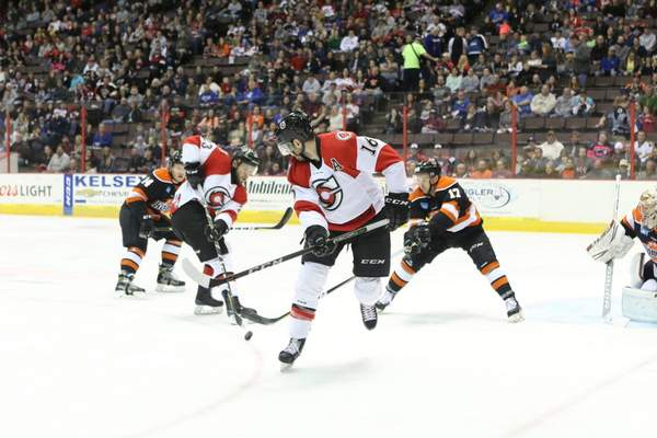 Tony Bailey Photography  Cincinnati Cyclones forward Shawn O'Donnell waits for a pass to come to him from Alex Kile, as Fort Wayne's Bobby Shea, right, and Gabriel Desjardins, left, defend at U.S. Bank Arena on Saturday night in Cincinnati.