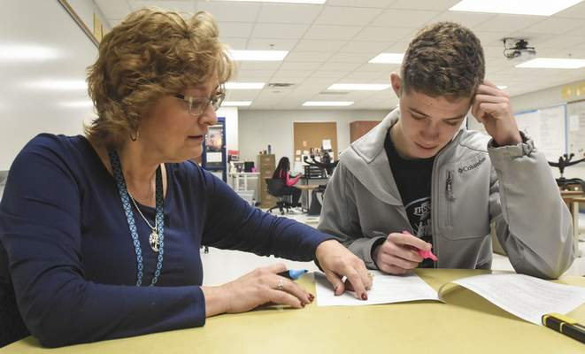 Michelle Davies | The Journal Gazette Special education teacher Michelle Abel works with Jack Just, a senior at Carroll High School, on strategies for reading comprehension.
