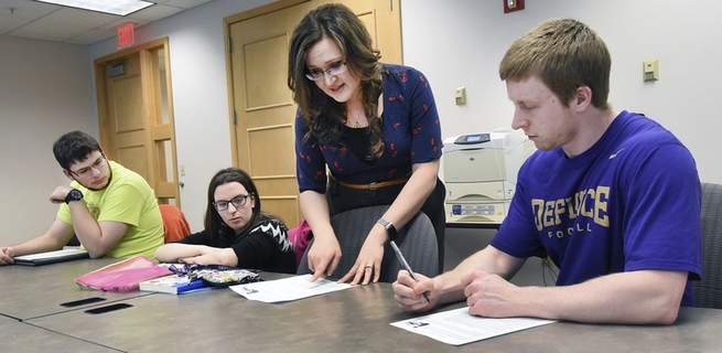 Photos by Cathie Rowand | The Journal Gazette  Becca Rupp, program coordinator for Defiance College's Affinity Program, explains a project to students, from left, Bill Smith, Emma Bedan and Nick Eberly.  (The_Journal_Gazette)