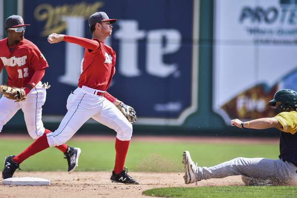 Mike Moore | The Journal Gazette TinCaps short stop Justin Lopez throws the ball to first base for a double play in the fifth inning against Beloit Wednesday afternoon at Parkview Field.