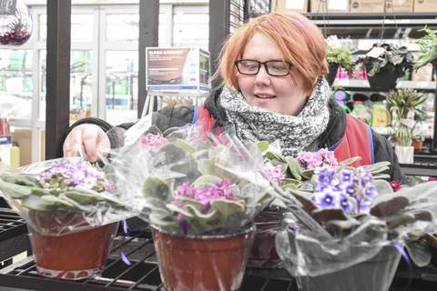 Michelle Davies | The Journal Gazette Shelby Mealer used assistance from Easterseals Arc of Northeast Indiana to get a job in the gardening department of Lowe's.